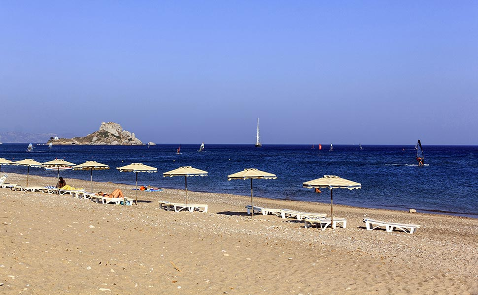 Beach in Kamari - Kefalos with view to islet Kastri