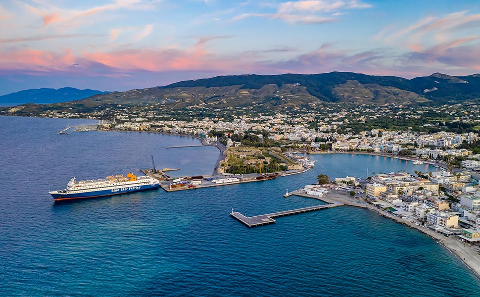 Aerial panoramic view of Kos port with Blue Star Ferry moored.