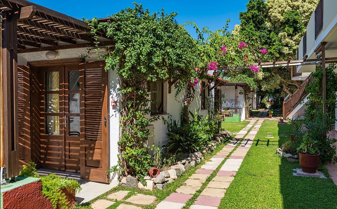 Lush green garden at Gaia Gaia Hotel in Kos